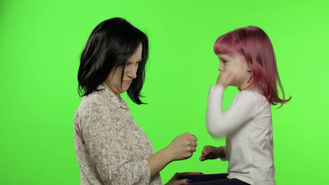 Mother and little daughter playing rock paper scissors. Chroma Key. Leisure game Live Action