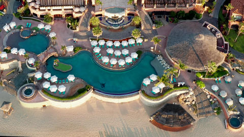 Aerial of Cabo resort hotel buildings and swimming pool, getaway destination Live Action