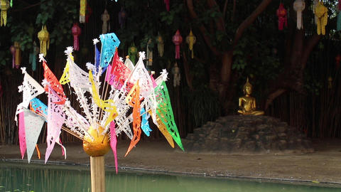 Buddha statue and cutting craft flags in Thai public temple Live Action