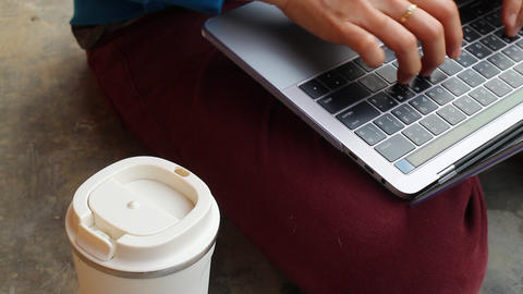 Serving internet on laptop and coffee drink Live Action