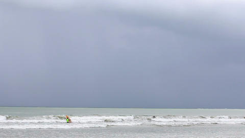 Surfers waiting for the waves in rainy day Footage