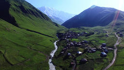 Ushguli mountain village 4k travel video. Aerial green valley river countryside Footage