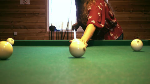Young woman playing billiard Footage