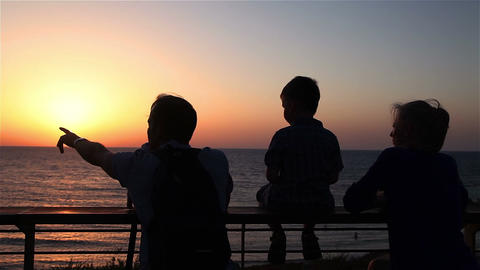 Silhouettes of family on a background of sunset Footage