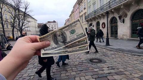 Three hundred dollar bills on blurred background of european street Live Action