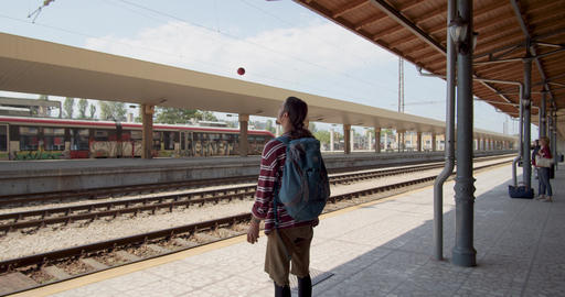 Young performer juggling balls on a railway station Live Action