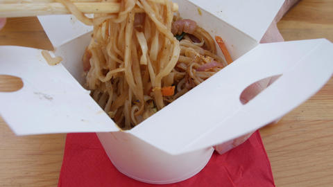 Asian noodles in a takeout box - chinese thai delicious vegan food Live Action
