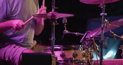 Musician plays drums during concert Live Action