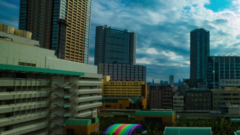 A timelapse of cityscape at the urban city in Tokyo high angle wide shot panning Live Action