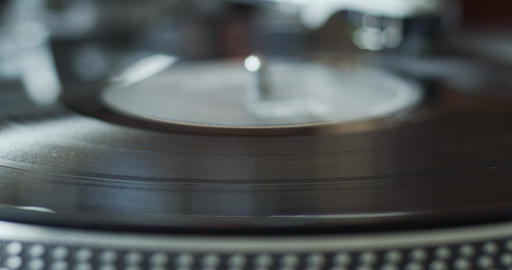 Vinyl record starts spinning on a professional gramophone analog player Live Action