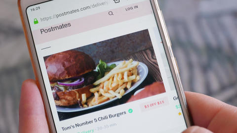 Using Smartphone Buying in Internet Shop Ordering dinner Online Store POV Live Action