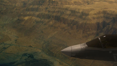 Fighter aircraft Flying Above Rocky Mountains Live Action