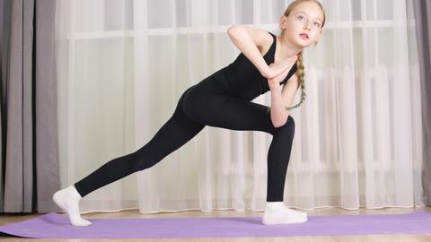 Yoga girl practicing Utthita Parsvakonasana on home training. Fit girl training Live Action