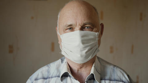 Elderly man in protective mask Live Action