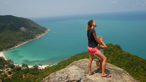 Mom and daughter look at the sea from viewpoint. Asia Live Action