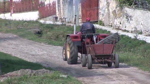a tractor dragging a cart Footage