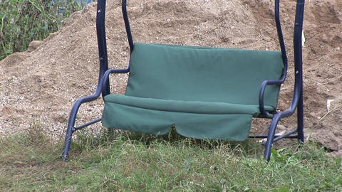 Empty rocking chair balanced by wind Live Action