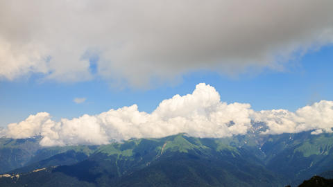Clouds over the mountain ridge. Time Lapse. Krasnaya Polyana, Sochi, Russia Footage