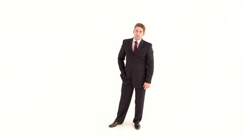 Businessman in the Suit Stands on a White Background Live Action