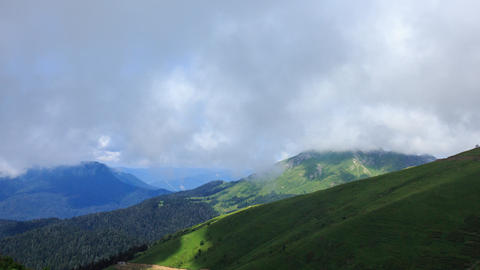 Green meadows under the clouds. Time Lapse, Sochi, Russia Footage