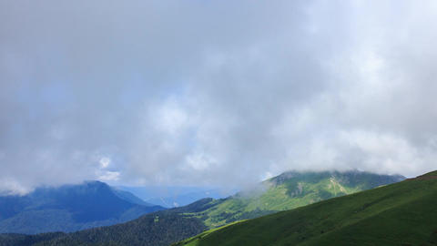Green meadows under the clouds. Zoom. Time Lapse, Sochi, Russia Footage