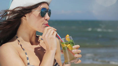 Hot lady enjoying exotic cocktail, long drink, vacation at luxury resort's beach Footage