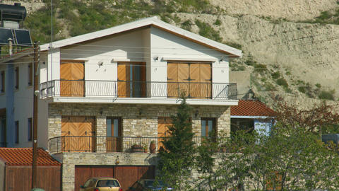 Establishing shot of two story building. House, villa in peaceful resort town Footage