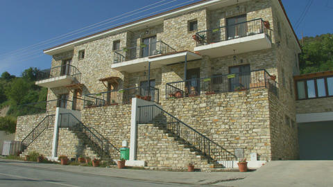 Two story masonry house in quiet resort town, establishing shot. Holiday villa Footage