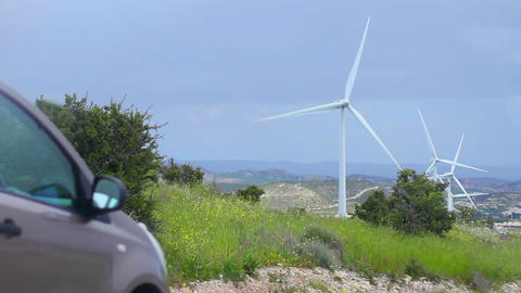 Technical progress, natural environment conservation, wind farm, electric car Footage