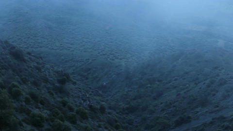 Thick fog covering mountains in darkness, mysterious atmosphere, horror film Live Action