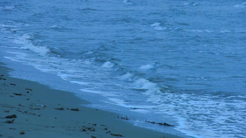 Loopable shot of waves washing sandy beach. Choppy water surface. Feeling lonely Footage