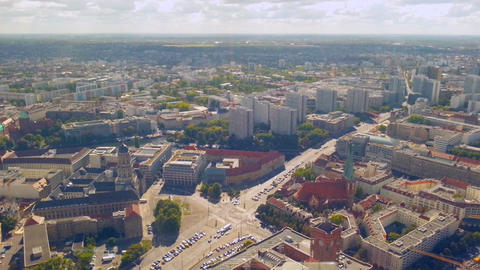 Aerial view of busy street intersection in Berlin. Cars stop at traffic lights Footage