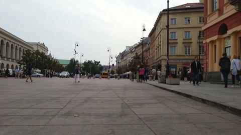 Time lapse of people walking on square and street traffic in European city Footage