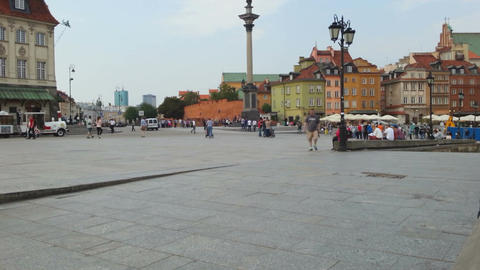 Time-lapse of people walking across square in historic part of Warsaw, Poland Footage