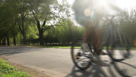 Young people competing, riding bicycles fast, enjoying summer weekend in park Footage