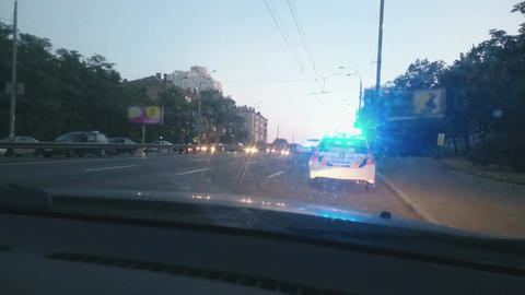 Parked police car with blue roof lights twirling, emergency, city road accident Footage