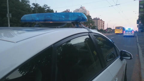 Closeup blue flashing police lights on top of patrol car, crime scene, emergency Footage