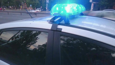Close-up flashing lights of emergency vehicle, blue flashers on police car, 911 Footage
