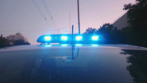 Blue police lights flashing on patrol car, emergency vehicle, law enforcement Footage