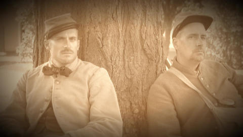 Two tired Civil War soldiers resting by tree (Archive Footage Version) Live Action