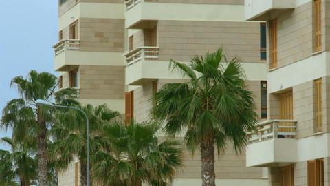 Establishing shot of luxury hotel at exotic resort. Summer vacation at seaside Footage
