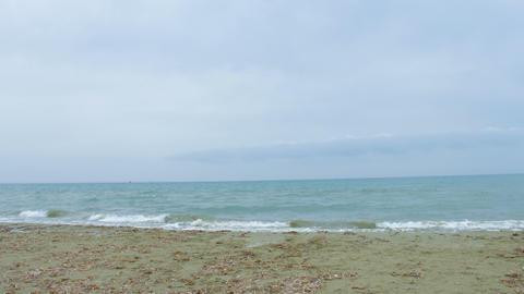 Endless sea with foamy waves splashing at seashore. Summer vacation at resort Footage