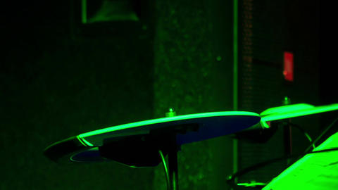 Closeup Drummer Plays on Plates in Night Bar under Flashes Live Action
