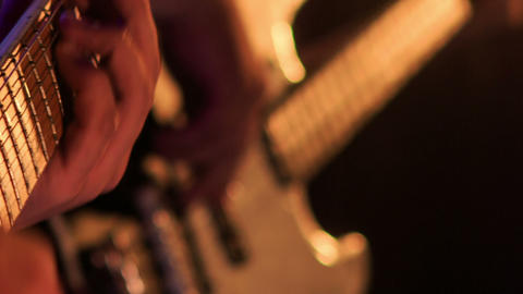 Closeup Guitarist Touches Strings on Finger-board in Night Bar Footage