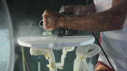 Surfboard shaping, Shaper using a tool to blow the foam of the surfboard blank Footage
