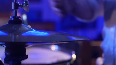Male hands hit on the plates drum Live Action