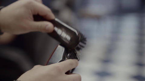 Preparation of tools for a haircut. Barber brushes his work tools Live Action