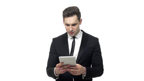 Slow-motion Shocked businessman with tablet computer reading bad news or looking Live Action