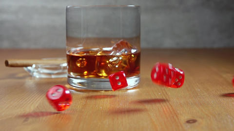 Dice on a Wooden Table and Whiskey in Highball. Slow Motion Live Action