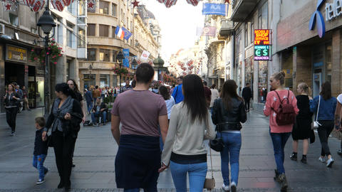 Loving couple walking holding hands in most famous tourist street in Belgrade Live Action